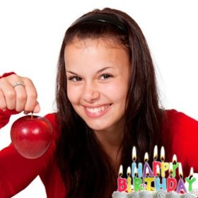 Birthday postcard with lighted candles on a cake