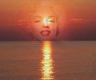 Photo collage of a sunset, in shades of red, with a cut face or a photograph. This appears in transparency, focusing on the image.
