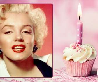 Pink birthday card with a picture frame and a cupcake with a candle.