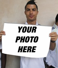 Photomontage with Cristiano Ronaldo, from the Real Madrid football team, holding a poster with the photo you upload online to internet.
