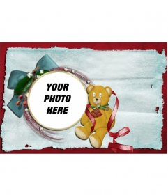 Christmas card with a teddy bear and ribbon.