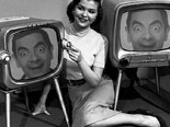 Photomontage in which you will leave in two old TV with a young woman lying between