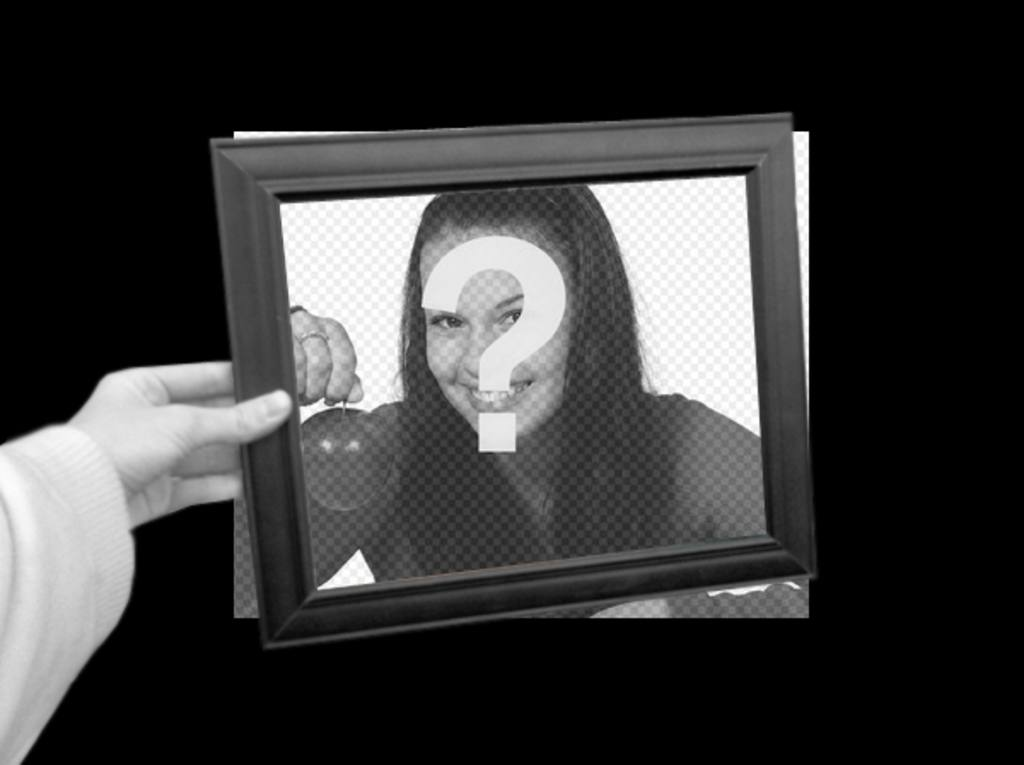 Curious photomontage in which your photo will appear as black and white background and within the photo frame of a hand holding box color