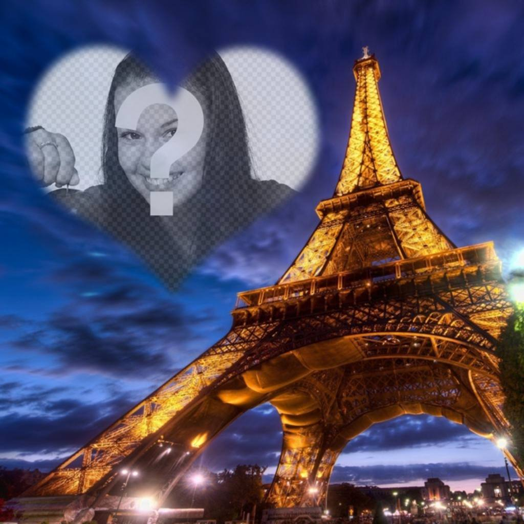Photomontage in Paris with the illuminated Eiffel Tower and a semitransparent heart shaped photoframe in the sky to place your photo