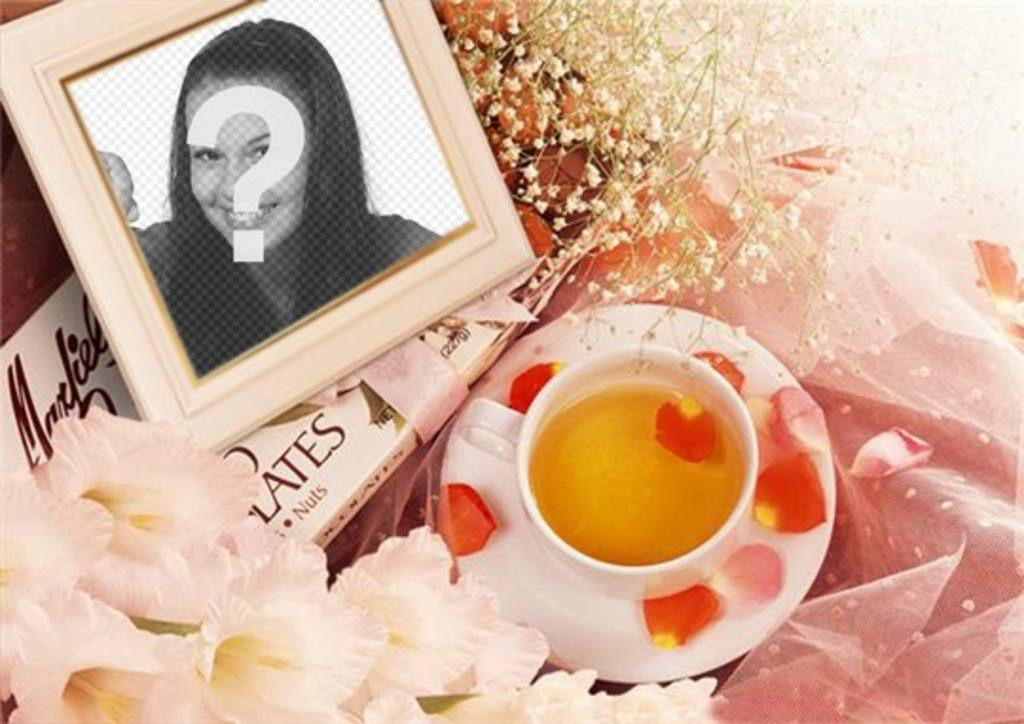 Photo frame with flowers to put your picture with rose petals and a cup of tea